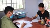 Facebooker Đặng Thanh tại cơ quan công an. Ảnh: CACC