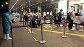 Passengers get health check at Van Don International Airport.