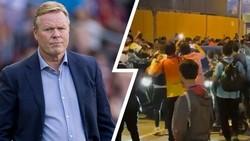 HLV Ronald Koeman bị bao vây khi rời sân Canp Nou.