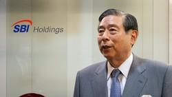 Giám đốc điều hành Yoshitaka Kitao của tập đoàn tài chính SBI Holdings.  Ảnh: Reuters