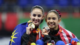Hoa khôi TDDC Farah Ann (trái) thi đấu ấn tượng tại SEA Games 30. Ảnh: KHƯƠNG DUY