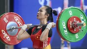 Lực sĩ Vương Thị Huyền chờ được chọn tham dự Olympic.