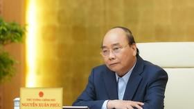 Thủ tướng Nguyễn Xuân Phúc chủ trì họp 15-4. Ảnh: VIẾT CHUNG