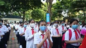 Học sinh dự lễ khai giảng tại trường THCS Giảng Võ, Hà Nội. Ảnh: QUANG PHÚC