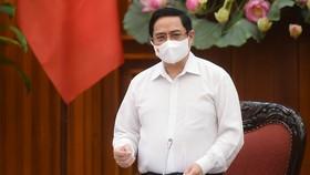 Thủ tướng Chính phủ Phạm Minh Chính tại cuộc họp Thường trực Chính phủ về phòng, chống dịch Covid-19. ẢNH: VIẾT CHUNG