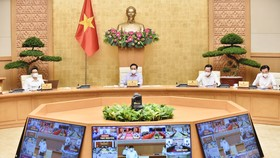 Thủ tướng Chính phủ Phạm Minh Chính chủ trì phiên họp trực tuyến toàn quốc về tình hình, giải pháp cấp bách phòng, chống dịch Covid-19. Ảnh: VIẾT CHUNG