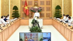 Thủ tướng Phạm Minh Chính chủ trì cuộc họp trực tuyến của Thường trực Chính phủ với TPHCM và các tỉnh Bình Dương, Đồng Nai, Long An. Ảnh: VIẾT CHUNG