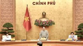 Thủ tướng chủ trì cuộc họp trực tuyến toàn quốc của Ban Chỉ đạo quốc gia phòng chống Covid-19 với các địa phương ngày 9-10. Ảnh: VIẾT CHUNG