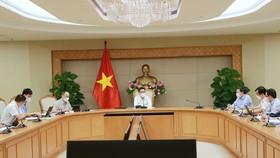Phó Thủ tướng Vũ Đức Đam chủ trì cuộc họp ngày 14-10. Ảnh: VIẾT CHUNG