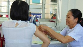 Vaccination is the best way to prevent seasonal flu (Photo: SGGP)