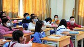 HCMC education department proposes free face masks for teachers, students