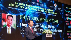 Minister of Information and Communications Nguyen Manh Hung is delivering his speech in the event. (Photo: VGP)