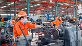 Companies set up temporary accommodations for workers to maintain production