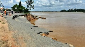 A 35 m- long section of National Highway 91 suddenly cracked and fell into the Hau River