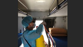 The worker disinfecting a train coach