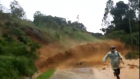 A person run out of the landslide-hit area.