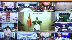 PM Pham Minh Chinh chairs the online meeting (Photo: VNA)