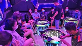 Two karaoke parlors fined, revoked business licenses for breaking Covid-19 rules