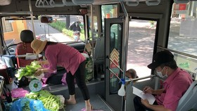 """HCMC launches """"mobile markets"""" on buses"""