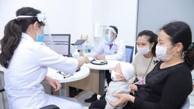 Trẻ tiêm chủng tại VNVC
