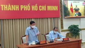 Đồng chí Trương Hòa Bình, Phó Thủ tướng Thường trực Chính phủ và Chủ tịch UBND TPHCM Nguyễn Thành Phong tại điểm cầu TPHCM