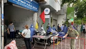 Phong tỏa hẻm 404 Nguyễn Đình Chiểu, quận 3 do liên quan đến một bệnh nhân Covid-19. Ảnh: CAO THĂNG