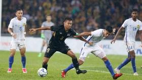 Thái Lan (giữa) luôn chứng tỏ vị thế anh cả ở làng bóng đá vùng trũng Đông Nam Á. Ảnh: Nhật Anh