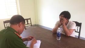 Tài xế Nguyễn Văn Hùng tại cơ quan Công an
