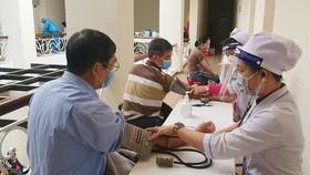 Lâm Đồng bắt đầu tiêm vaccine phòng Covid-19 cho lái xe, phụ xe tải