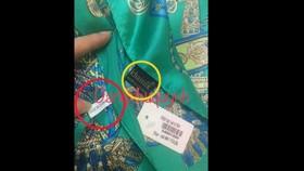 """Trên một chiếc khăn của Khaisilk vừa có nhãn """"Khaisilk - Made in Viet Nam"""" vừa có nhãn """"made in China"""""""