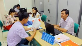 Vietnam has nearly five million household businesses which contribute about 30 percent of the country's gross domestic product (GDP). Fee exemptions for enterprise registration are expected to reduce business operating costs. (Photo: luatvietphong.vn)