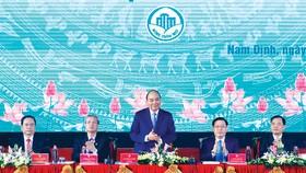 Thủ tướng Nguyễn Xuân Phúc cùng các đồng chí lãnh đạo tại hội nghị. Ảnh: TTXVN