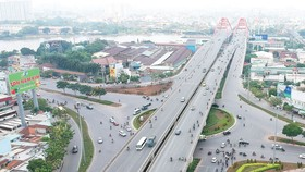 Hạ tầng giao thông khu vực đường Phạm Văn Đồng, quận Thủ Đức, TPHCM được đầu tư xây dựng hiện đại. Ảnh: CAO THĂNG