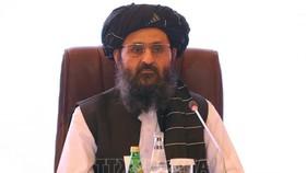 Trưởng đoàn đàm phán của Taliban Mullah Abdul Ghani Baradar, trong cuộc đàm phán với đại diện chính phủ Afghanistan ngày 18-72021. Ảnh: AFP/TTXVN