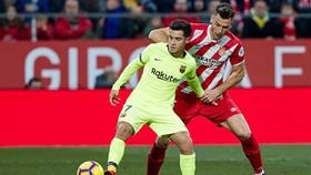 Philippe Coutinho (trái) đang trải qua quãng thời gian khó khăn ở Barca. Ảnh: Getty Images