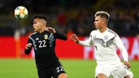 Argentina (trái) với đội hình trẻ trung ngược dòng thủ hòa 2-2 trước chủ nhà tuyển Đức. Ảnh: Getty Images