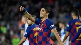 Luis Suarez tin năng lực ghi bàn tốt sẽ giúp anh có được hợp đồng mới. Ảnh: Getty Images