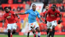 Thành Mancheser sẽ sôi sục với trận derby đầu tiên của mùa giải tại Old Trafford vào ngày 12-12. Ảnh: Getty Images
