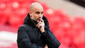HLV Pep Guardiola đang tập trung cao độ cho màn nước rút cuối mùa. Ảnh: Getty Images