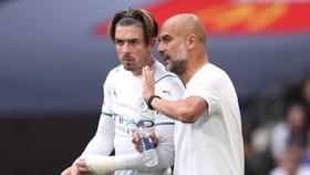 Jack Grealish tin rằng HLV Pep Guardiola có thể giúp anh phát triển tốt nhất. Ảnh: Getty Images