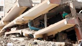 Một vụ sập nhà ở Nairobi. Ảnh: AP.