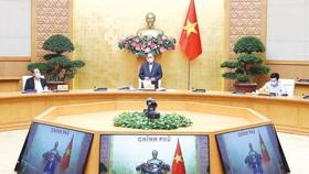 Thủ tướng Nguyễn Xuân Phúc phát biểu kết luận cuộc họp. Ảnh: TTXVN