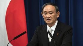 Tân thủ tướng Nhật Yoshihide Suga phát biểu trong cuộc họp báo tại Tokyo hôm 16-9. Ảnh: REUTERS