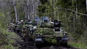 Thiết giáp Warrior được triển khai trong quân đội Anh. Ảnh:  REUTERS