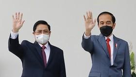 Thủ tướng Phạm Minh Chính đến chào xã giao Tổng thống Indonesia Joko Widodo, chiều 23-4. Ảnh: TTXVN