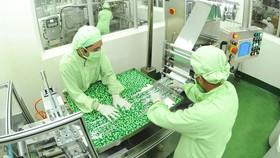 Doanh nghiệp trong nước sử dụng dây chuyền sản xuất tiên tiến. Ảnh: CAO THĂNG