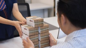 Tín dụng mua nhà tăng 20%/năm trong 5 năm qua, cao hơn con số tăng trưởng 15,4% của toàn ngành. Ảnh: Dũng Minh.