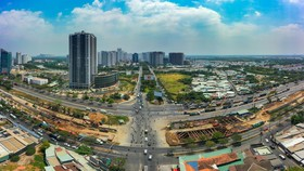 Sở Xây dựng TPHCM đề nghị có các biện pháp xử lý kịp thời đề bình ổn thị trường bất động sản, không xảy ra tình trạng sốt giá và bong bóng bất động sản. Ảnh: Chí Hùng.