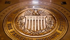 The central bank signaled it would do practically anything to help an American economy in a race against time. PHOTO: ANDREW HARNIK/ASSOCIATED PRESS