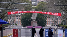 Security guards standing in front of an entrance to Tongji University in Shanghai on March 12. PHOTO: ALY SONG/REUTERS